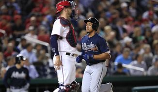 Atlanta Braves Johan Camargo (17) runs to home plate and scores while Washington Nationals catcher Matt Wieters (32) waits for the ball during the fourth inning of a baseball game in Washington, Tuesday, Sept. 12, 2017. (AP Photo/Manuel Balce Ceneta)