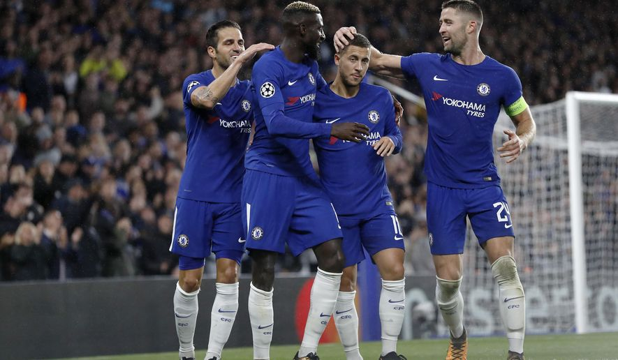 Chelsea's Tiemoue Bakayoko, second from left, celebrates with his teammates after scoring during the Champions League group C soccer match between Chelsea and Qarabag at Stamford Bridge stadium in London, Tuesday, Sept. 12, 2017. (AP Photo/Kirsty Wigglesworth)
