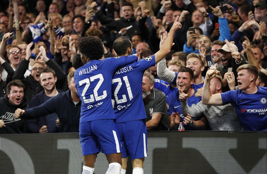 Chelsea's Davide Zappacosta, right, celebrates with his teammate Willian after scoring during the Champions League group C soccer match between Chelsea and Qarabag at Stamford Bridge stadium in London, Tuesday, Sept. 12, 2017. (AP Photo/Kirsty Wigglesworth)