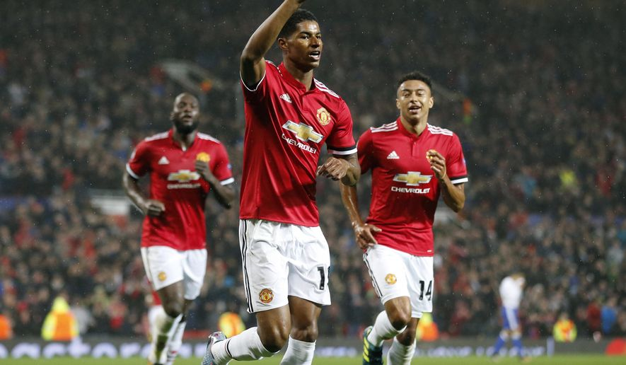 Manchester United's Marcus Rashford, center, celebrates his goal during the Champions League group A soccer match between Manchester United and Basel, at the Old Trafford stadium in Manchester, Tuesday, Sept. 12, 2017. (AP Photo/Frank Augstein)