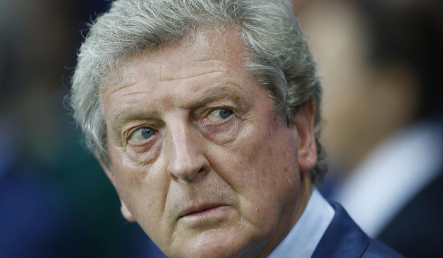 FILE - In this file photo dated Monday, June 27, 2016, England coach Roy Hodgson looks on before the Euro 2016 round of 16 soccer match between England and Iceland, at the Allianz Riviera stadium in Nice, France. Former England coach Roy Hodgson has been hired as manager of Crystal Palace, replacing the fired Frank de Boer at the struggling English Premier League club.(AP Photo/Kirsty Wigglesworth, FILE)