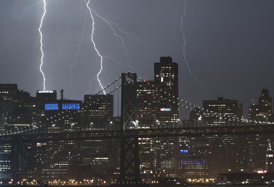 Seen from Oakland, Calif., lightning forks over the San Francisco skyline on Monday, Sept. 11, 2017. (AP Photo/Noah Berger)