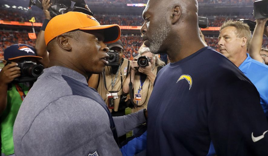 Denver Broncos head coach Vance Joseph, left, greets Los Angeles Chargers head coach Anthony Lynn after an NFL football game, Monday, Sept. 11, 2017, in Denver. The Broncos won 24-21. (AP Photo/Jack Dempsey)