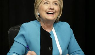 "Hillary Rodham Clinton signs copies of her book ""What Happened"" at a book store in New York, Tuesday, Sept. 12, 2017. (AP Photo/Seth Wenig)"