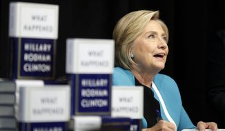 """Hillary Rodham Clinton signs copies of her book """"What Happened"""" at a book store in New York, Tuesday, Sept. 12, 2017. (AP Photo/Seth Wenig)"""