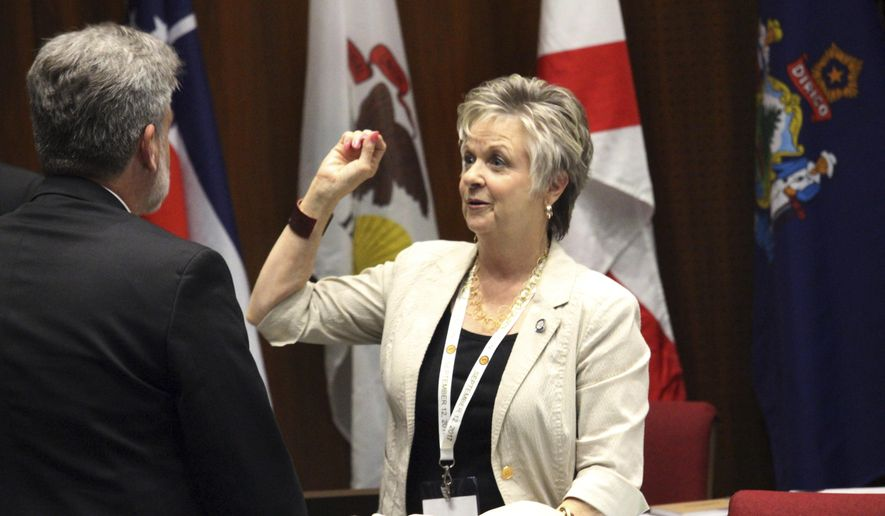 Oklahoma state Sen. Julie Daniels speaks with another Republican delegate to a balanced budget planning convention at the Arizona Capitol in Phoenix on Sept. 12, 2017. Lawmakers from 19 states are trying to develop a plan in Arizona this week for carrying out a growing, but unlikely, national effort to amend the Constitution to require a balanced U.S. budget. The plan is to add an amendment through a convention, a long-shot effort that has never been successfully done. (AP Photo/Bob Christie)