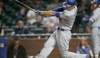 Los Angeles Dodgers' Corey Seager hits a single to drive in two-runs against the San Francisco Giants during the fourth inning of a baseball game, Monday, Sept. 11, 2017, in San Francisco. (AP Photo/Tony Avelar)