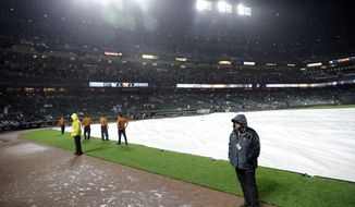 The field is covered with a tarp for a rain delay during a baseball game between the San Francisco Giants and the Los Angeles Dodgers, Monday, Sept. 11, 2017, in San Francisco. (AP Photo/Marcio Jose Sanchez)