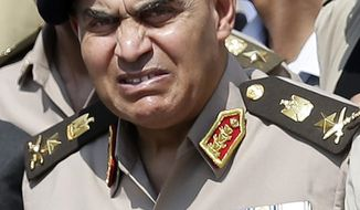 FILE - In this Sept. 20, 2013 file photo, then Army Chief of Staff Lt. Gen. Sedki Sobhi attends the funeral of Giza Police Gen. Nabil Farrag in Cairo, Egypt. South Korea's news agency said Tuesday Sept. 12, 2017, that Sobhi, Egypt's defense minister, on a visit to Seoul, announced his country has cut military ties with North Korea. There was no immediate confirmation from the Egyptian government of the agency's report, but the move follows Washington's decision last month to cut or delay $300 million in military and economic aid to Egypt over its human rights record and ties with Pyongyang. (AP Photo/Hassan Ammar, File)