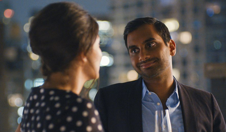 """This image released by Netflix shows Aziz Ansari in a scene from, """"Master of None.""""  Ansari is nominated for an Emmy Award for outstanding lead actor in a comedy series, the sole Asian-American acting nominee. (Netflix via AP)"""