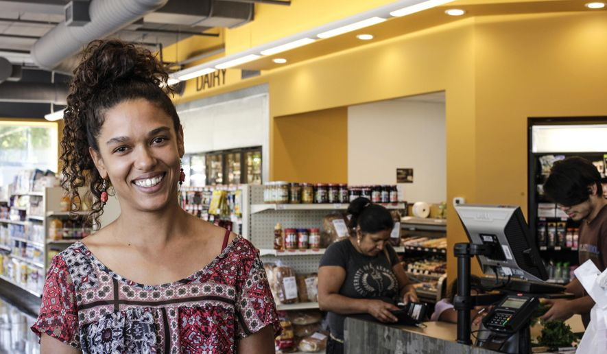 ADVANCE FOR USE SATURDAY, SEPT. 16 - In this Aug. 23, 2017 photo, Wirth Co-op Grocery Board Member Kristel Porter poses in the grocery store in Minneapolis. Wirth Co-op Grocery is a new grocery store in north Minneapolis that provides a healthy selection of food for the community. (Maria Alejandra Cardona/Minnesota Public Radio via AP)