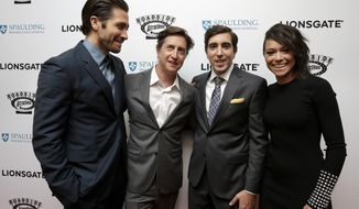 "Actor Jake Gyllenhaal, left, director David Gordon Green, center left, Boston Marathon bombing survivor Jeff Bauman, center right, and actress Tatiana Maslany, right, arrive on the red carpet Tuesday, Sept. 12, 2017, at the U.S. premiere of the movie ""Stronger"" at the Spaulding Rehabilitation Hospital in Boston. The U.S. premiere of the film that chronicles the story Bauman. Gyllenhaal plays Bauman, while Maslany plays Bauman's then-girlfriend Erin Hurley in the film. (AP Photo/Steven Senne)"