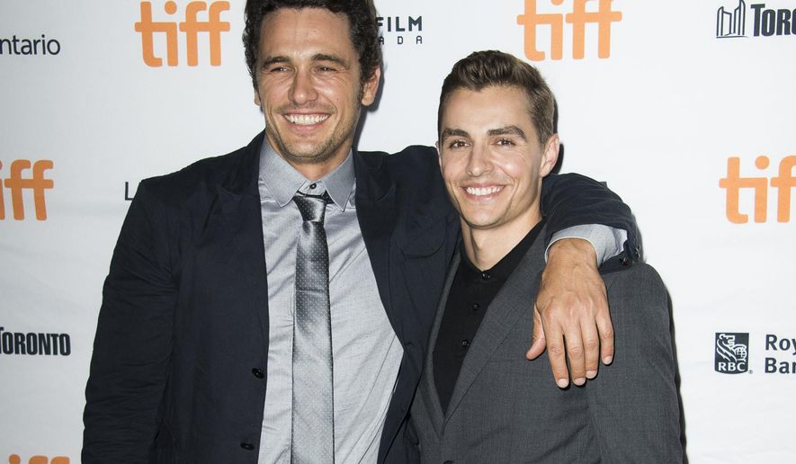 """FILE - In this Sept. 11, 2017 file photo, director James Franco, left, and his actor brother Dave Franco attend a premiere for """"The Disaster Artist"""" on day 5 of the Toronto International Film Festival in Toronto. (Photo by Arthur Mola/Invision/AP, File)"""