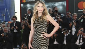 "FILE - In this Sept. 5, 2017 file photo, actress Michelle Pfeiffer poses for photographers at the premiere of the film ""mother!"" at the 74th edition of the Venice Film Festival in Venice, Italy. Pfeiffer stars in Darren Aronofsky's allegorical thriller. (Photo by Joel Ryan/Invision/AP, File)"