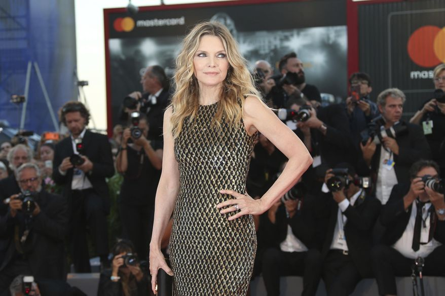 """FILE - In this Sept. 5, 2017 file photo, actress Michelle Pfeiffer poses for photographers at the premiere of the film """"mother!"""" at the 74th edition of the Venice Film Festival in Venice, Italy. Pfeiffer stars in Darren Aronofsky's allegorical thriller. (Photo by Joel Ryan/Invision/AP, File)"""