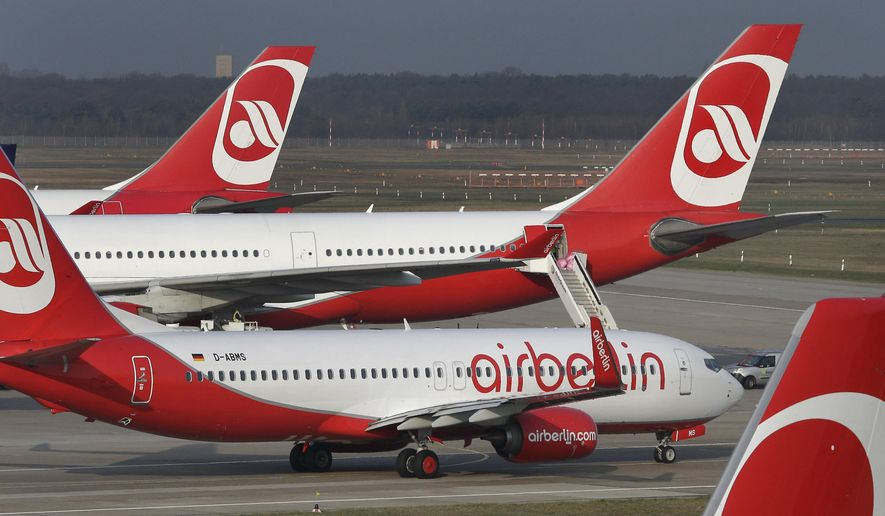 FILE - In this April 2, 2014 file photo airplanes of the German airline 'Air Berlin' are pictured at the Tegel airport in Berlin, Germany.  Air Berlin had to caoncel dozens of flights on Tuesday, Sept. 12, 2017.  (AP Photo/Michael Sohn, file)