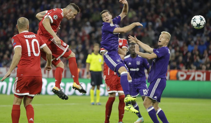 Bayern's Niklas Suele, second left, heads the ball toward the goal during a Champions League Group B soccer match between FC Bayern Munich and RSC Anderlecht in Munich, Germany, Tuesday, Sept. 12, 2017. (AP Photo/Matthias Schrader)