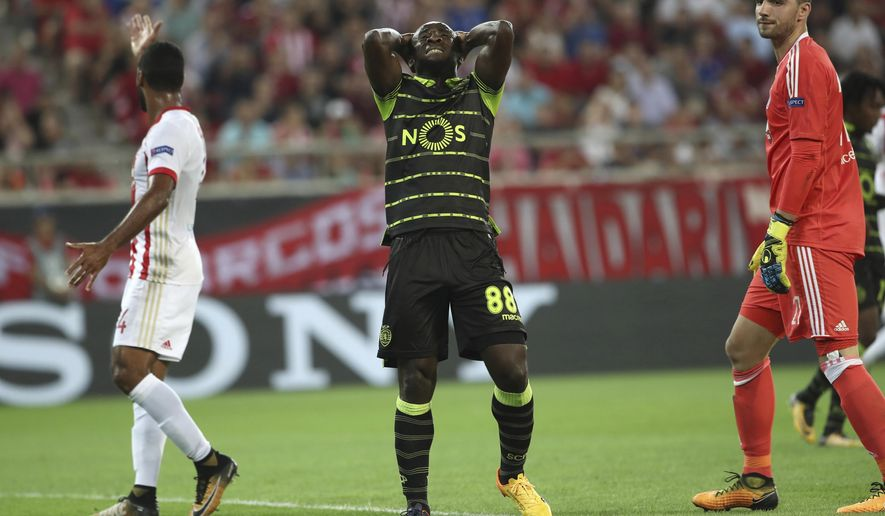 Sporting's Seydou Doumbia, centre, reacts after missing a scoring chance during the Group B Champions League soccer match between Olympiakos and Sporting CP at Georgios Karaiskakis stadium in Piraeus port, near Athens, Greece, on Tuesday, Sept. 12, 2017. (AP Photo/Petros Giannakouris)