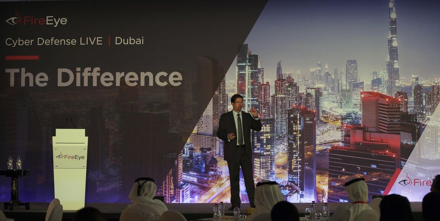 Tony Cole, Vice President of FireEye Inc., a cybersecurity firm headquartered in Milpitas, California, speaks at the FireEye Cyber Defence Live conference, Tuesday, Sept. 12, 2017, in Dubai, United Arab Emirates. State-sponsored hacks have become an increasing worry among countries across the Persian Gulf. They include suspected Iranian cyberattacks on Saudi Arabia to leaked emails causing consternation among nominally allied Arab nations. (AP Photo/Kamran Jebreili)
