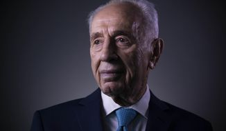 FILE - In this Feb. 8, 2016, file photo, former Israeli President Shimon Peres poses for a portrait at the Peres Center for Peace in Jaffa, Israel. Peres had an unprecedented seven decades of public service packed with historic triumphs and painful setbacks. In a memoir completed shortly before his death in 2016, that came out Tuesday, Sept. 12, 2017, the former Israeli president and prime minister offers his trademark optimistic blueprint for future leadership but also a rare glimpse into key chapters of his extraordinary life. (AP Photo/Oded Balilty, File)