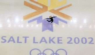 This Feb. 8, 2002, file photo shows U.S. champion Michelle Kwan practicing for the women's short program for the Winter Olympic Games at the Salt lake Ice Center in Salt Lake City. There's an outside shot the United States won't have to wait 11 years to host its next Olympics. It's a longshot, but there's talk in Salt Lake City, and even some in Denver, of a bid for the 2026 Winter Games, which take place two years before the Summer Olympics return to Los Angeles. (AP Photo/Doug Mills, file)