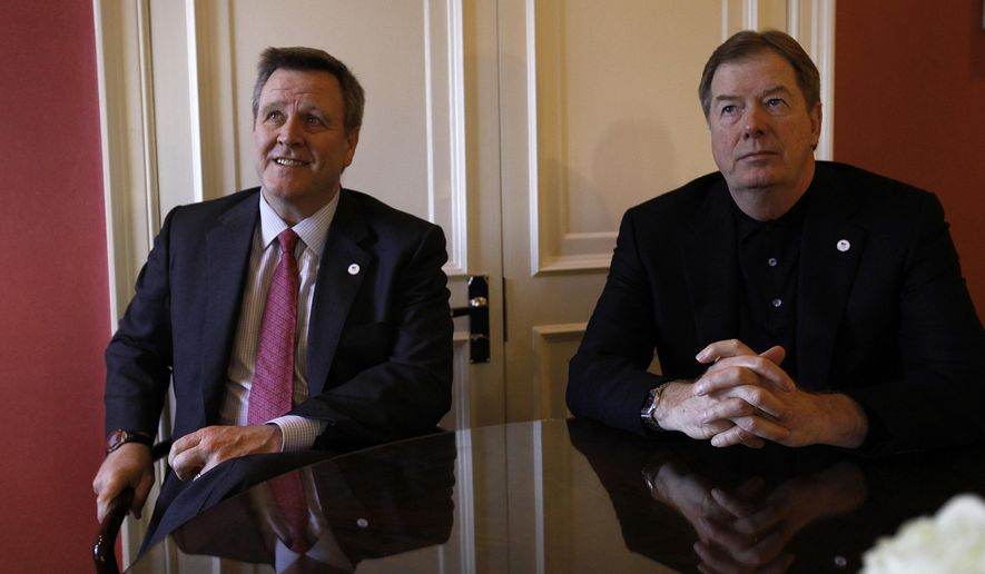 FILE - In this Jan. 11, 2012, file photo, United States Olympic Committee Chairman Larry Probst, right, and USOC CEO Scott Blackmun are shown during an interview in London. It took eight years, a nice-sized dose of humble pie and more than a few failures, but Blackmun and Probst succeeded. The International Olympic Committee will award Los Angeles the 2028 Games at a ceremony on Wednesday, Sept. 13, 2017. It will be the first Summer Olympics awarded to the U.S. in 27 years, when the IOC gave the 1996 Games to Atlanta. It will end a string of embarrassing losses: New York for 2012, and Chicago for 2016. (AP Photo/Alastair Grant)
