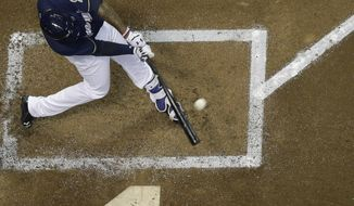 Milwaukee Brewers' Domingo Santana hits a two-run scoring double during the third inning of a baseball game against the Pittsburgh Pirates Tuesday, Sept. 12, 2017, in Milwaukee. (AP Photo/Morry Gash)