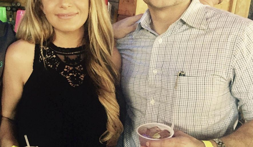 This August 2017 photo provided by Paul Hargrave shows Hargrave with girlfriend Crystal McDowell. McDowell, a 37-year-old Realtor and mother of two, went missing Aug. 25, the day Hurricane Harvey made landfall in Texas. Her ex-husband, Steven McDowell, was charged with her murder on Saturday, Sept. 9. (Paul Hargrave via AP)