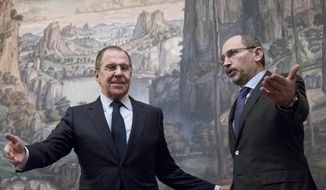 "In this Jan. 24, 2017, file photo, Russian Foreign Minister Sergey Lavrov, left, welcomes Jordanian Foreign Minister Ayman Al Safadi during their meeting in Moscow, Russia. Lavrov said Monday, Sept. 11, 2017 that Saudi Arabia assured him it backs a Moscow-led process of negotiating gradual local cease-fires in Syria, including the establishment of ""de-escalation zones."" Lavrov spoke after a meeting Monday with his Jordanian counterpart and a day after talks with Saudi leaders. (AP Photo/Pavel Golovkin, File)"