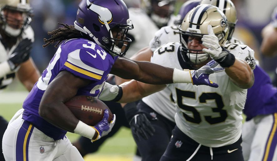 Minnesota Vikings running back Dalvin Cook, left, runs from New Orleans Saints linebacker A.J. Klein (53) during the first half of an NFL football game, Monday, Sept. 11, 2017, in Minneapolis. (AP Photo/Jim Mone)