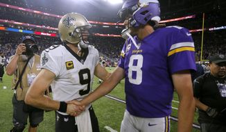 New Orleans Saints quarterback Drew Brees, left, talks with Minnesota Vikings quarterback Sam Bradford after an NFL football game, Monday, Sept. 11, 2017, in Minneapolis. The Vikings won 29-19. (AP Photo/Bruce Kluckhohn)