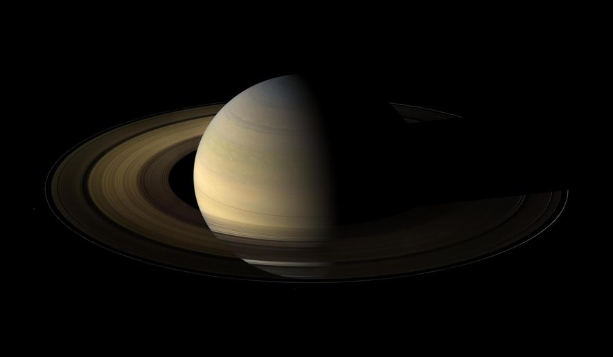 This Aug. 12, 2009 composite image made available by NASA shows Saturn in equinox seen by the approaching Cassini spacecraft. Saturn's equinox occurs only once in about 15 Earth years. (NASA/JPL/Space Science Institute via AP)