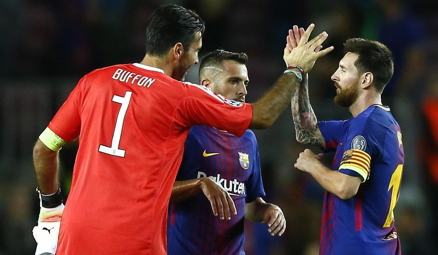 Barcelona's Lionel Messi shakes hands with Juventus goalkeeper Gianluigi Buffon at the end of a group D Champions League soccer match between FC Barcelona and Juventus at the Camp Nou stadium in Barcelona, Spain, Tuesday, Sept. 12, 2017. (AP Photo/Manu Fernandez)