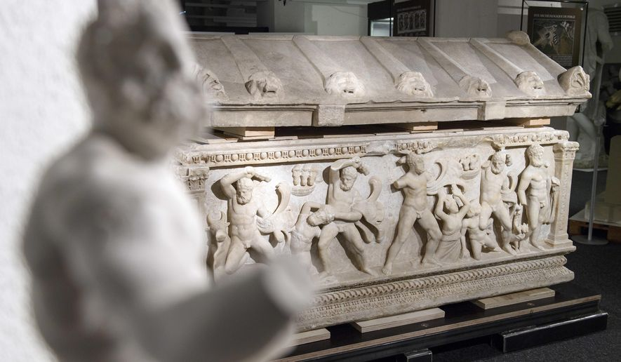 FILE - In this June 22, 2017 file photo a Roman sarcophagus is on display in Geneva. The coffin was discovered by Swiss customs in a warehouse in Geneva in 2010 and will be returned to Turkey.  (Martial Trezzini/Keystone via AP)