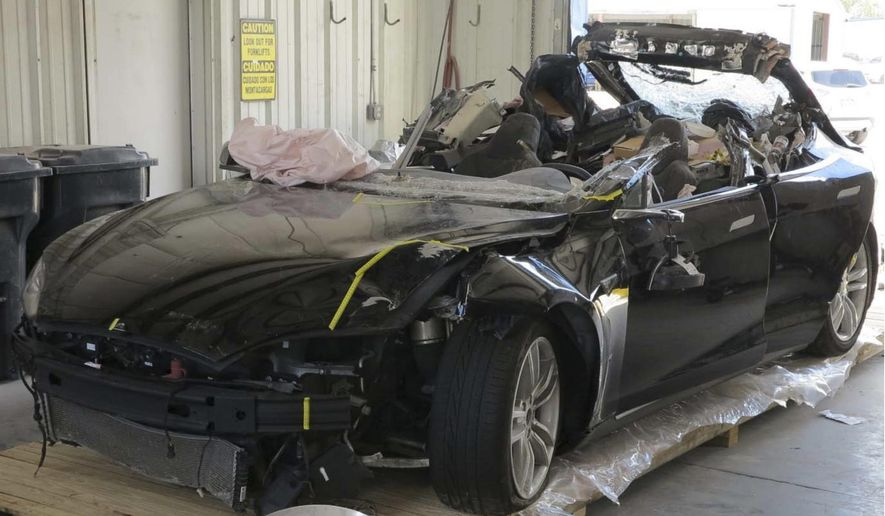 This image provided by the National Transportation Safety Board shows the damage to the left front of the Tesla involved in a May 7, 2016, crash in Williston, Fla. Investigators are meeting Sept. 12, 2017, to determine the likely cause of the crash that killed Joshua Brown, 40, of Canton, Ohio, who was using the semiautonomous driving systems of his Tesla Model S sedan. The sedan struck the underside of a semitrailer that was turning onto a divided highway in Williston. The sedan's roof was sheared off before the vehicle emerged on the other side of the trailer.(NTSB via AP)