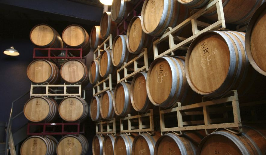 This undated image provided by Finger Lakes Tourism shows wine barrels at Heron Hill Winery in Hammondsport, N.Y., in the Finger Lakes region. The area is known for wineries and scenic countryside around 11 long, narrow lakes in central New York, about 250 miles northwest of New York City. Fall is a popular time of year to visit thanks to the harvest season and autumn foliage. (Finger Lakes Tourism via AP)