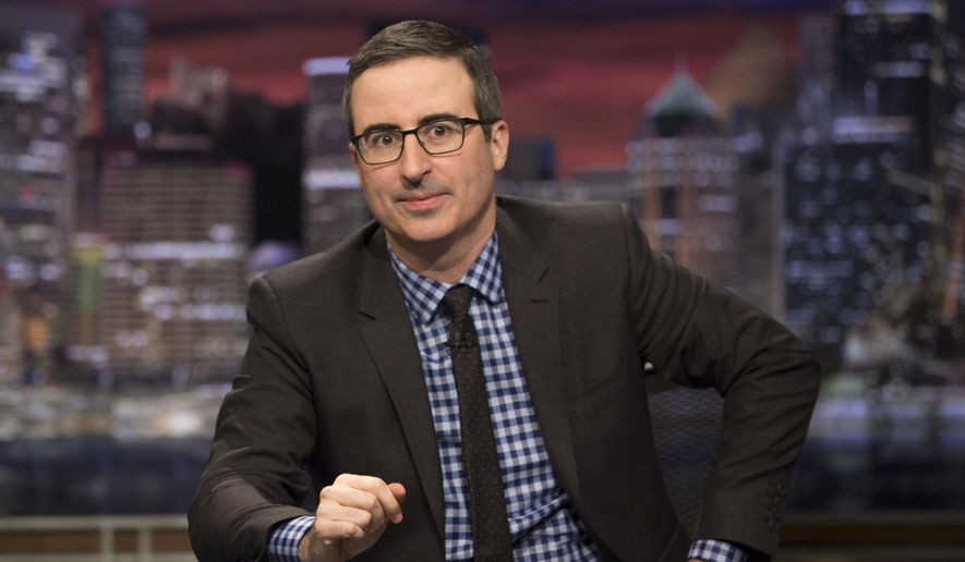 """This image released by HBO shows John Oliver, host of """"Last Week Tonight with John Oliver."""" HBO says it has renewed the show for three additional seasons.   (Eric Liebowitz/HBO via AP)"""