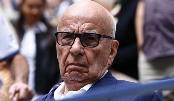 In this Sunday, Sept. 10, 2017, file photo, Rupert Murdoch waits for the start of the men's singles final of the U.S. Open tennis tournament between Rafael Nadal, of Spain, and Kevin Anderson, of South Africa, in New York. (AP Photo/Julio Cortez, File)
