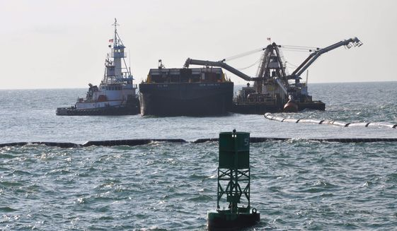 A Spider Barge (right) distributes outer-channel sediment into a barge held in place by a tug boat (left), as a Cutter Head Dredge Alaska (outside frame) pumps material through the pipe. The work is part of the Savannah Harbor Expansion Project. The outer channel will extend up to 20 miles into the Atlantic when complete, making the entire shipping channel 40 miles long from entry to Garden City Terminal. Image courtesy of U.S. Army Corps of Engineers.