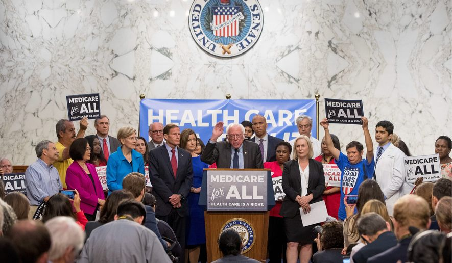 "Sen. Bernard Sanders, Vermont independent (center) unveiled his ""Medicare-for-all"" bill Wednesday. Democrats who have presidential aspirations have enthusiastically signed on to Mr. Sanders' bill and are insisting that this proposed single-payer healthcare system won't blow a hole in the federal budget. (Associated Press)"