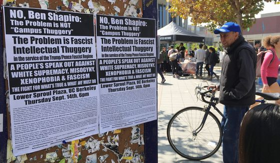 "Signs have been posted at the University of California, Berkeley, campus calling for a protest Thursday against right-wing speaker Ben Shapiro. The university will seal off large parts of its campus with a closed perimeter and a ""very large"" visible police presence. (Associated Press)"
