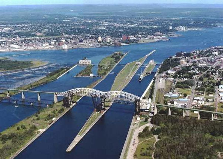 Aerial photo of Soo Locks, a vital waterway for iron ore and other maritime commerce between Lake Superior and Lake Huron that first opened in 1855. Today, only two of its four locks are operable, and only one  the Poe Lock  can handle the largest lake freighters. Image courtesy of U.S. Army Corps of Engineers.