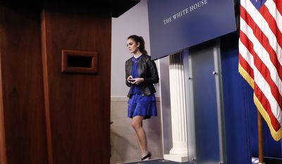 In this photo taken Feb. 14, 2017, Hope Hicks, adviser to President Donald Trump, walks to her seat before the start of the daily briefing in the Brady Press Briefing Room of the White House in Washington. A White House official says Hicks will serve temporarily as White House communications director. Hicks, will work with press secretary Sarah Huckabee Sanders to help set White House messaging strategy.  (AP Photo/Pablo Martinez Monsivais)