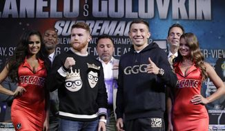 Canelo Alvarez, left, and Gennady Golovkin pose for photographers during a news conference Wednesday, Sept. 13, 2017, in Las Vegas. The two are scheduled to fight in a middleweight title fight Saturday in Las Vegas. (AP Photo/John Locher)
