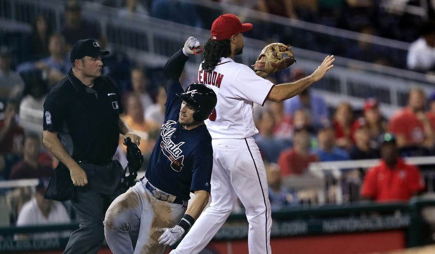 Atlanta Braves' Lane Adams (16), slides safely into third on his triple while Washington Nationals third baseman Anthony Rendon, right, waits for the ball during the fifth inning of a baseball game in Washington, Wednesday, Sept. 13, 2017. Adams later scored a run on teammate Ozzie Albies' single. (AP Photo/Manuel Balce Ceneta)