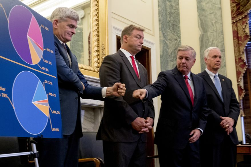 Sen. Bill Cassidy, R-La., left, and Sen. Lindsey Graham, R-S.C., second from right, accompanied by Sen. Dean Heller, R-Nev., second from left, and Sen. Ron Johnson, R-Wis., right, fist bump each other during a news conference on Capitol Hill in Washington, Wednesday, Sept. 13, 2017, to unveil legislation to reform health care. (AP Photo/Andrew Harnik)