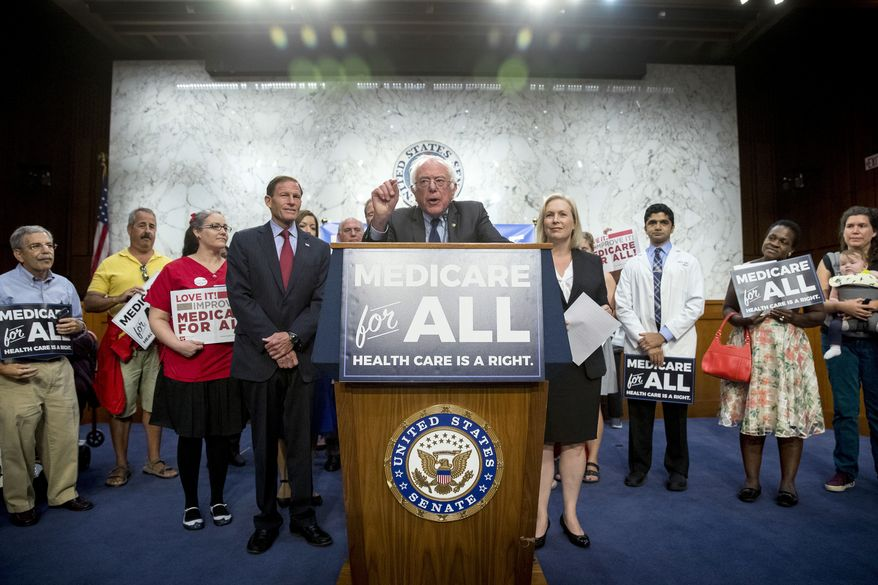 Sen. Bernie Sanders, I-Vt., center, joined by Sen. Richard Blumenthal, D-Conn., center left, Sen. Kirsten Gillibrand, D-N.Y., center right, and supporters, speaks at a news conference on Capitol Hill in Washington, Wednesday, Sept. 13, 2017, to unveil their Medicare for All legislation to reform health care. (AP Photo/Andrew Harnik)