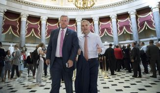 Rep. Mark Meadows, R-N.C., chairman of the conservative House Freedom Caucus, and Rep. Jim Jordan, R-Ohio, a key member of the group, walk through Statuary Hall at the Capitol in Washington, Wednesday, Sept. 13, 2017. (AP Photo/J. Scott Applewhite) ** FILE **