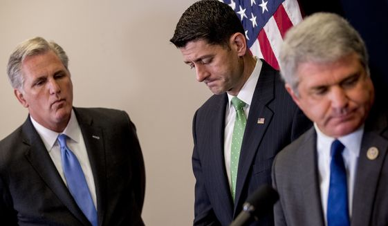 From left, House Majority Leader Kevin McCarthy of Calif. and House Speaker Paul Ryan of Wis., pause as Rep. Michael McCaul, R-Texas, steps away from the podium during a news conference following a GOP caucus meeting on Capitol Hill, Wednesday, Sept. 13, 2017, in Washington. (AP Photo/Andrew Harnik)