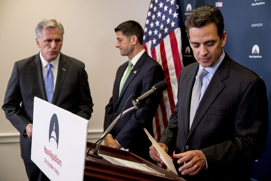 From left, House Majority Leader Kevin McCarthy of Calif., and House Speaker Paul Ryan of Wis., pause as Rep. Tom Graves, R-Ga., steps away from the podium during a news conference following a GOP caucus meeting on Capitol Hill, Wednesday, Sept. 13, 2017, in Washington. (AP Photo/Andrew Harnik)